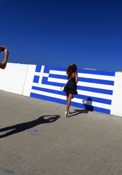 Greek flag and photographer in Faliraki