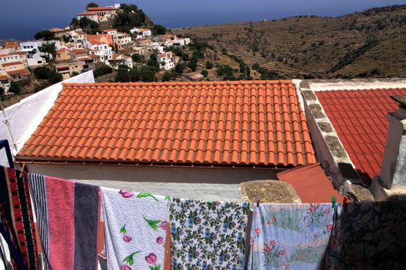 Landscape with tiled roofs and hanging laundry,Iouli