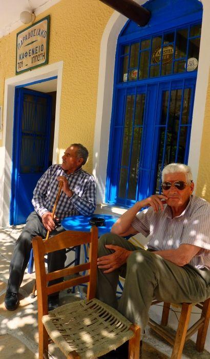Two men sitting at a kafeneio, Koronos