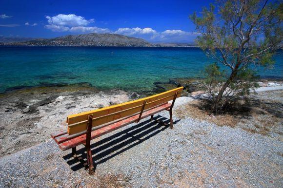 Eanteio waterfront with colorful bench, Salamina island, Saronic Gulf
