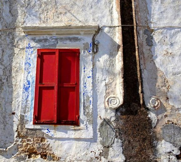 Old facade with red shutters