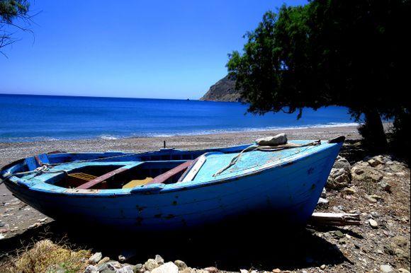 Eristos beach with blue boat