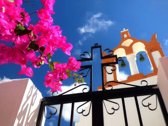 Church, gate and bougainvillea, Emborio