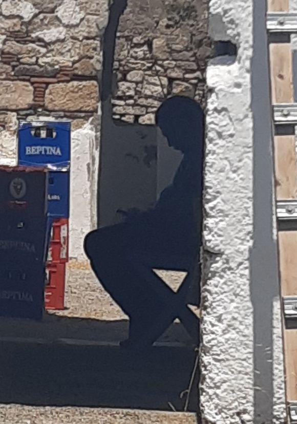 the man sitting