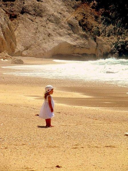 Baby girl on Myrtos sand
