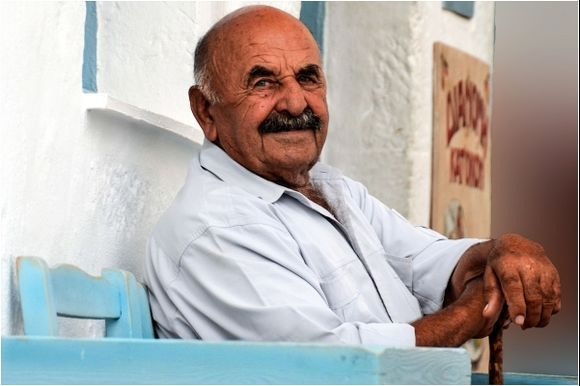 Waiting for friends to share a cigarette, ouzo and happy chat!