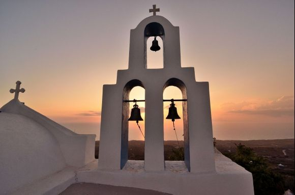 Sunset over beautiful Thirassia island, Santorini