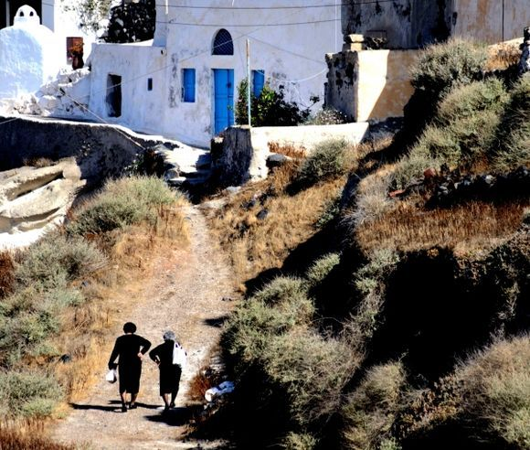 Two ladies in Thirassia, Potamos village....tired from the long walk home.