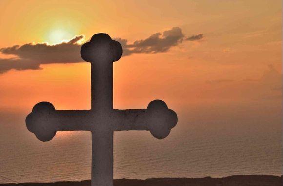 This cross overlooking the sunset in beautiful Thirassia Island(Santorini)