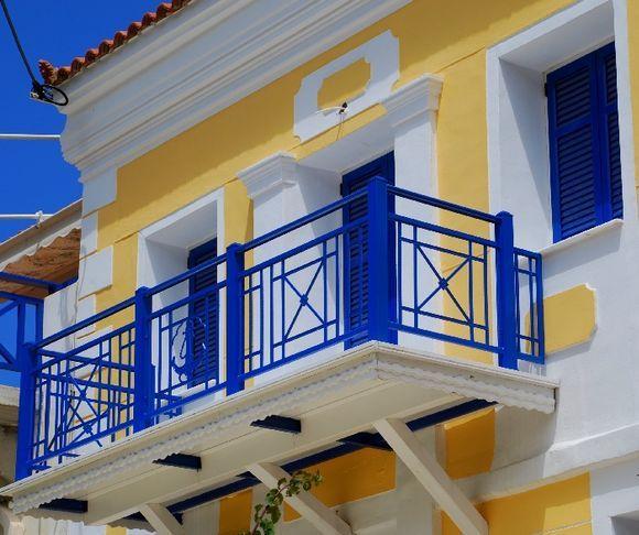sunny house, blue balcony