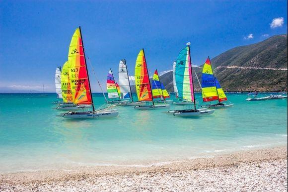 Beautiful sailboats resting near coast.
