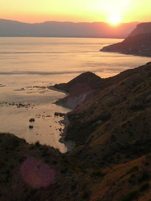 Sunset across Laganas Bay from the Gerakas peninsular. Daphni beach in foreground