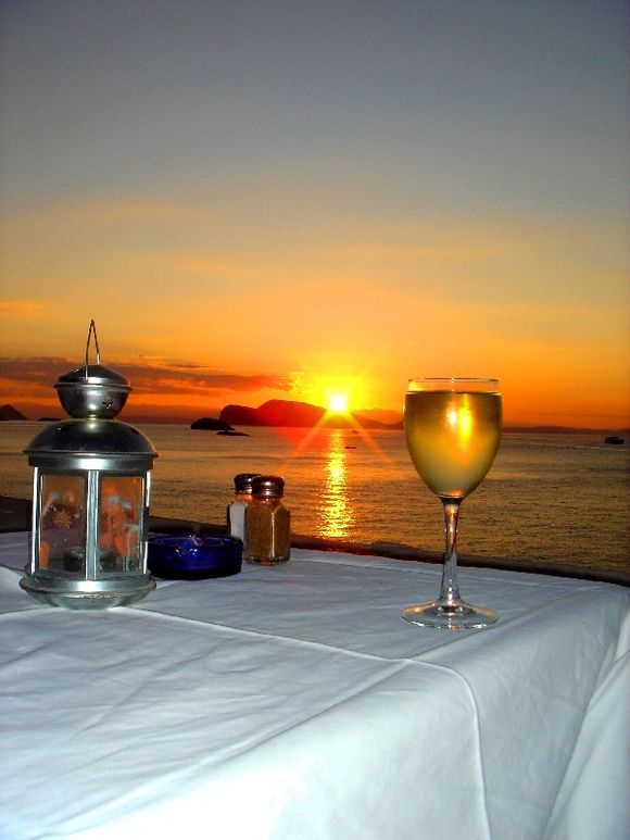 Enjoying a glass of wine and watching the sun go down at the Iliovasilema restaurant in Hydra.