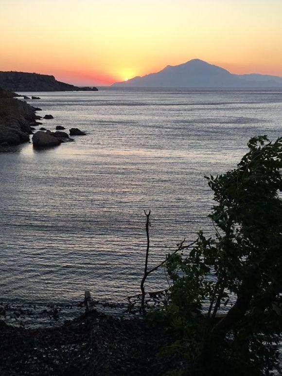 Sunrise behind Fourni from Therma Ikaria