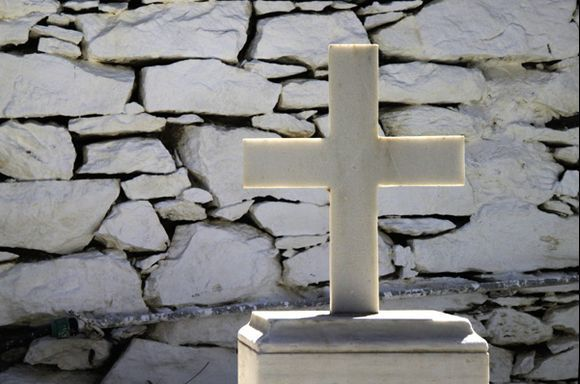 Cross and stone wall