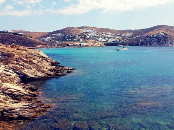 Mykonos august 2017,  Agrari and Elia are located near each other, forming a huge sandy beach, 10 kilometres from the island's capital. Agrari Beach is less popular than its neighbor Elia and much calmer. They both can be reached by local bus and by taxi-boat.