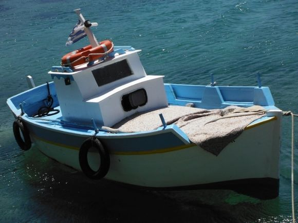Telendos island, a boat in the small harbour of the island