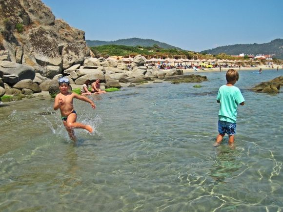 Platania Beach, a sandy bay located close to the village of Sarti and 88 km south east of Poligiros. Surrounded by lush green vegetation reaching the green blue sea the beach offers many spots for naturists.