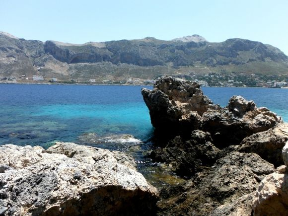 Telendos island, the official naturist Paradise beach, in the background the island of Kalymnos