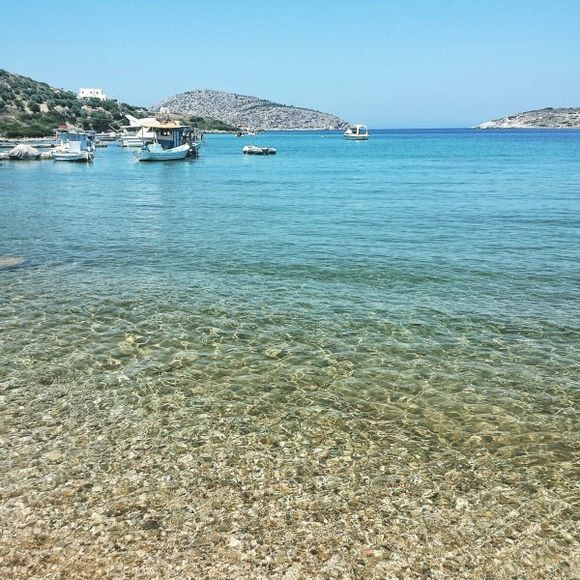 Leros july 2015, Alinda is located 3 km north west of Agia Marina and is the longest beach of Leros. Also this is one of the best organized areas with numerous facilities, leisure activities, plenty of water sports and fish taverns. The beach is only a short walk away from the settlement and consists of soft sand and crystalline waters. Pine trees are spread around the sandy coast providing nice shade. For those who want to avoid the summer crowds some quitter sandy coves are scattered around the main beach, such as the romantic beach of Krifo.