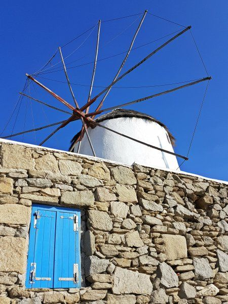 Mykonos august 2017, the windmills are the quintessential features of Mykonos landscape. There are plenty of them that have become a part and parcel of Mykonos. Visitors to Mykonos can see the windmills irrespective of the locale. From a distance one can easily figure out the windmills, courtesy of their silhouette.