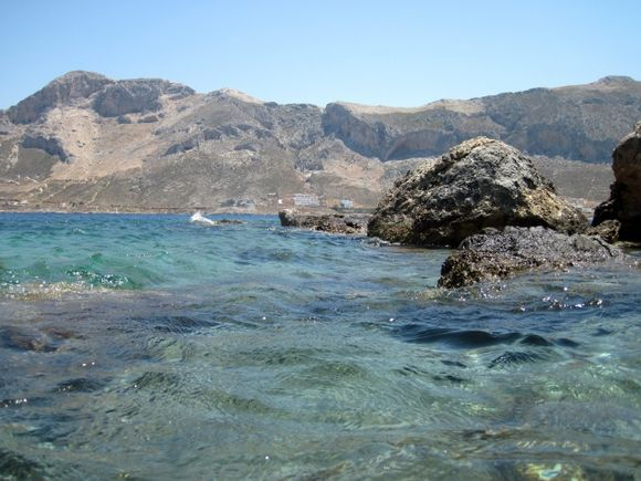 Telendos island, the official naturist Paradise beach, on the background the island of Kalymnos