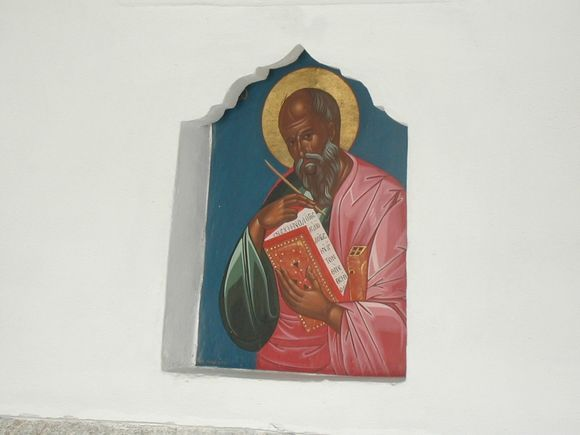 Patmos, painting of Agios Ioannis writing the Apocalypse book