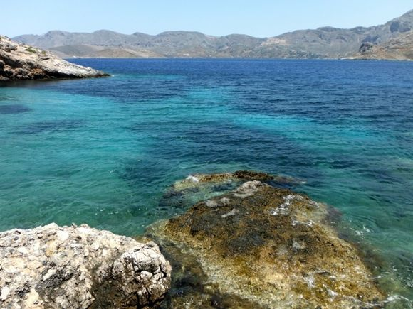 Telendos island, the official naturist Paradise beach, in the background Kalymnos island