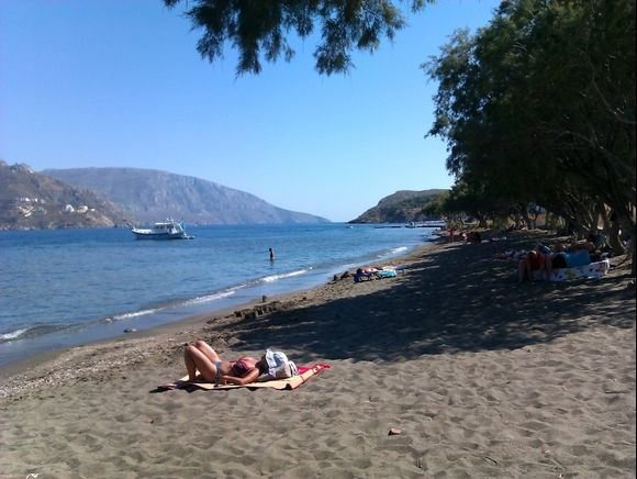 Telendos island, the quiet beach close to the small harbour of the island