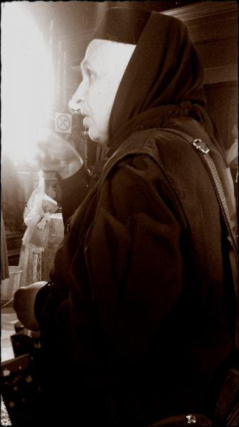 Corfu island, an old woman in Saint Spyridon church in Kerkira