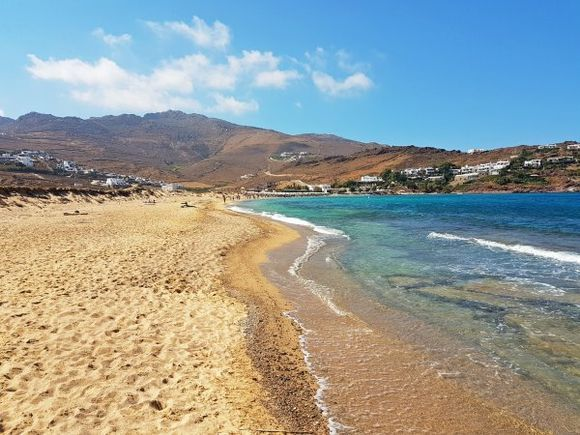 Mykonos august 2017, Panormos is located on the northern side of the island and it is much secluded. Away from tourist facilities and water sports centres, Panormos is a calm and non-organized beach. The right side it's naturist.