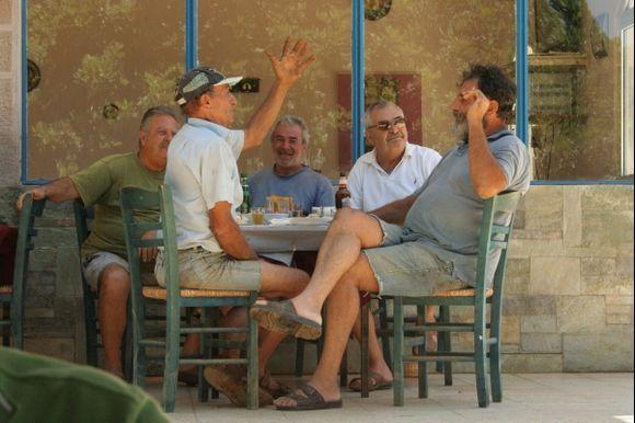 The wrath sing, goddess... Cretan men having a good time in a tavern