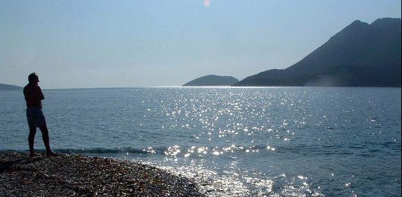 Man and sea. Agios Pavlos.