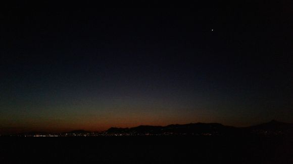 no, it is not the current conjunction of Jupiter and Saturn. I took this photo in 2017, a few hours before dawn.   it was amazing to see such a big star in the sky. unfortunately I was not able to find out what it was. Maybe someone knows. that is Egina in the distance