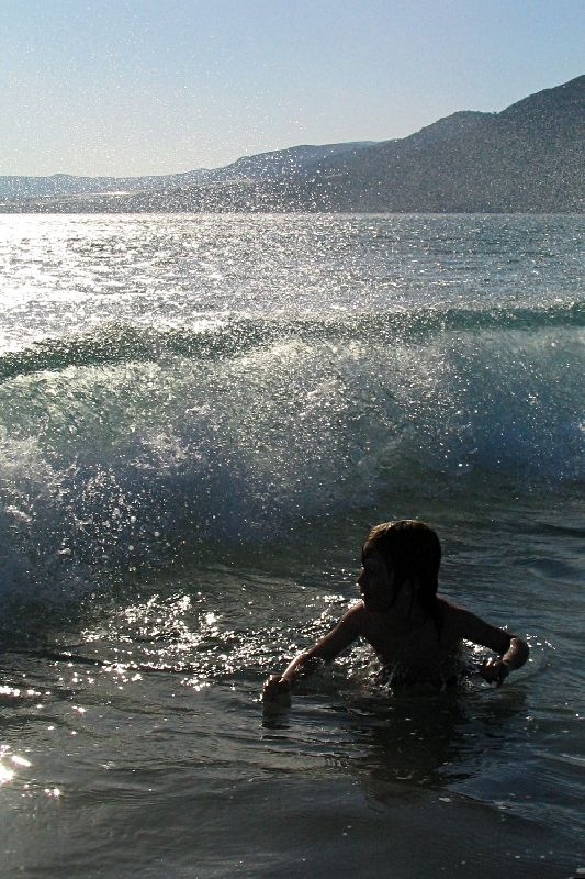 My son in the waves of Paleohora