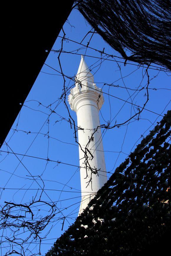 A white and slender minaret.