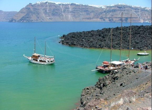 Santorini. Tour boat  leaving the volcano.