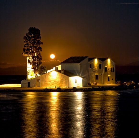 Bright moonrise at Vlacheran Monastery.. with golden tones.