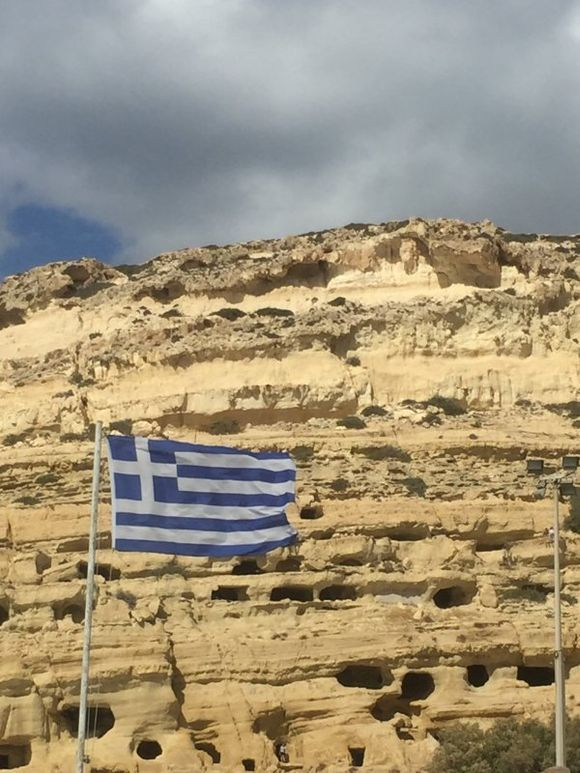Caves of Matala, Crete showing the Greek flag
