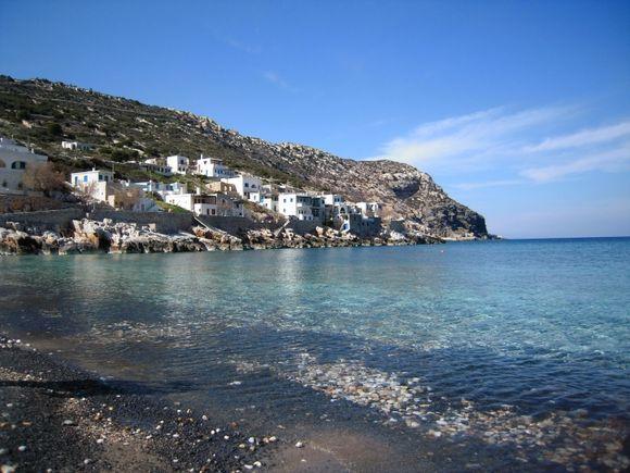 Lionas beach,some houses and fish tavern too.should come back in the summer for swimming and yummy sea food!