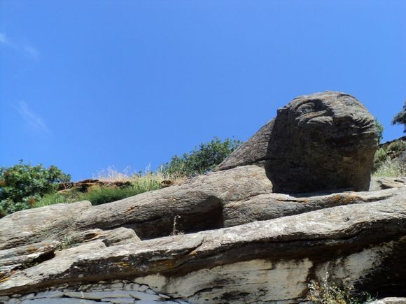 Stone Lion of Kea carved on the rocks