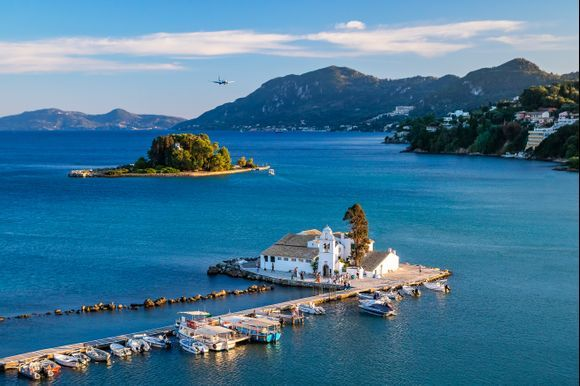 Beautiful view of Kanoni and Mouse island in Corfu with an airplane coming above.
