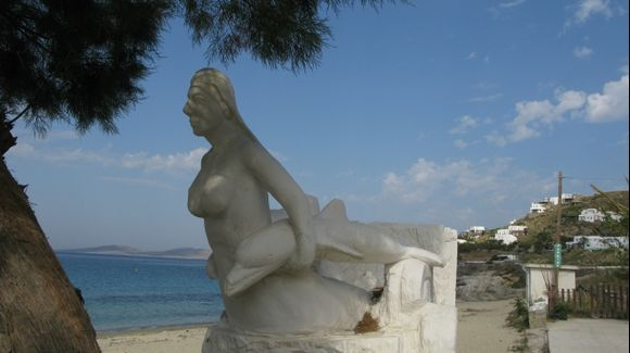 Mermaid with dolphin statue at  