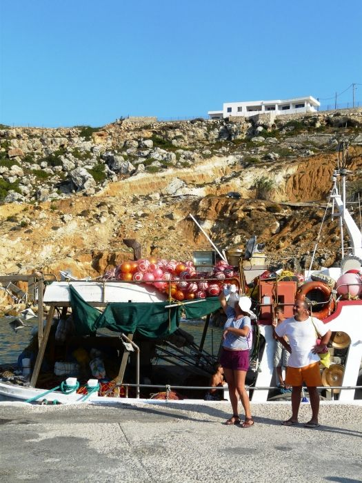 The local accomodation looks down from it\'s cliff over the port and it\'s fishing boats as we arrive on Antikythira off the ferry.