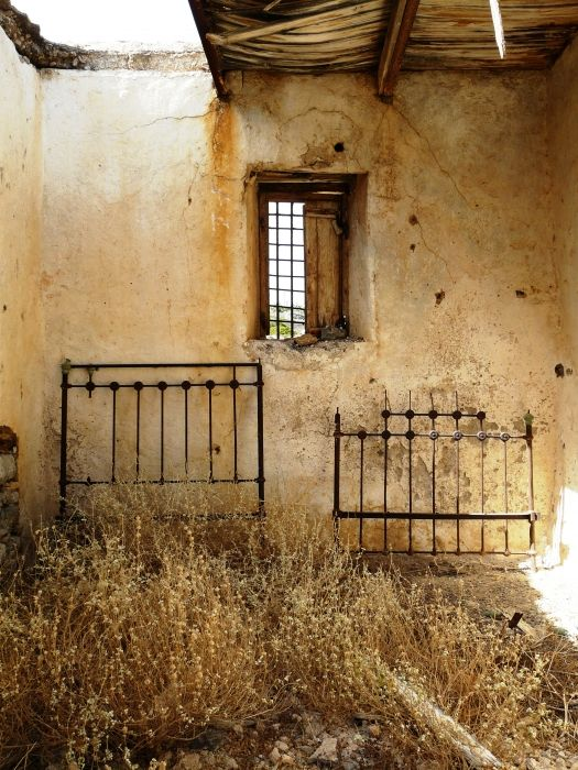 Old bed frames. What once was the bedroom in the ruins of the Katsanevas family home in \'Katsaneviana\' on Antikythira, a small island off Kythira.