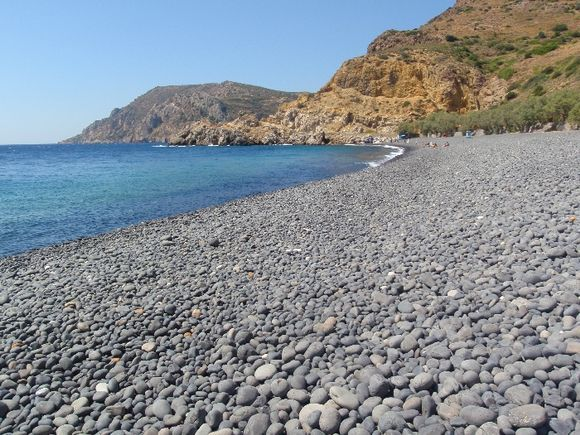 Black pebble beach ,Mavra Volia, a deep-water bay of volcanic rocks in South Chios nr Emporios
