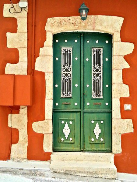 In the village of Vamos, exterior walls saturated in a sienna patina and stony door frames resembling concrete curtains that look like they've just been drawn to expose a cheery door drenched in chartreuse, welcomed us
